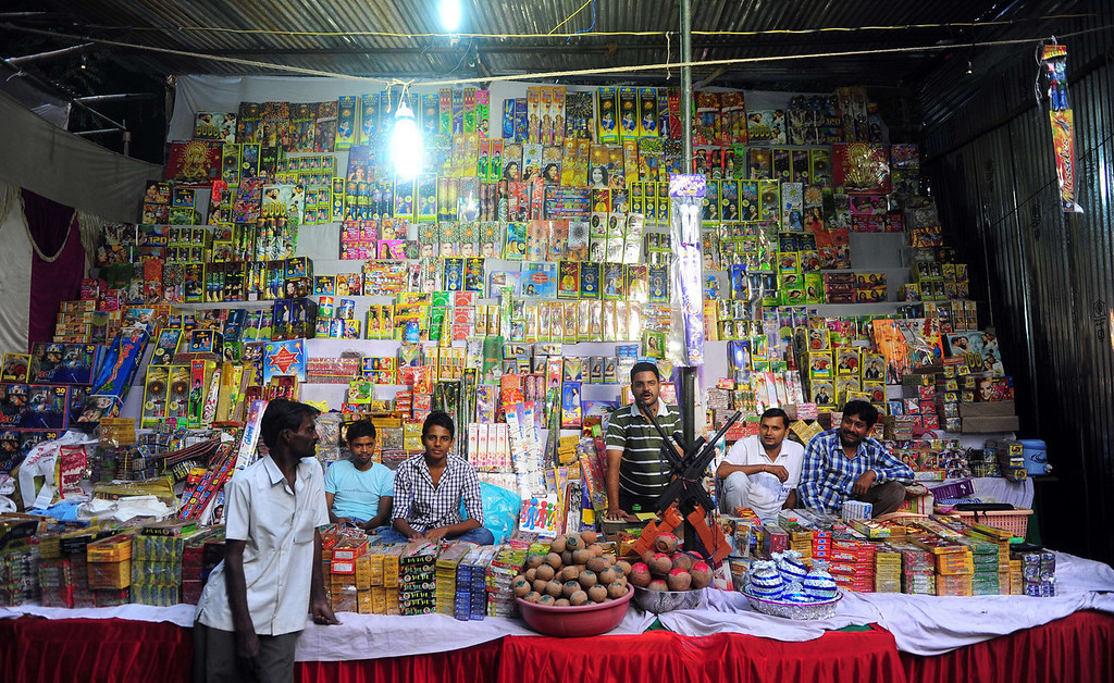 . Indian firecrackers venders wait for customers at a market ahead of Diwali, the Hindu festival of lights in Allahabad on October 31, 2013. Diwali, the Festival of Lights, marks victory over evil and commemorates the time when Hindu god Lord Rama achieved victory over Ravana and returned to his kingdom Ayodhya.  Sanjay Kanojia/AFP/Getty Images