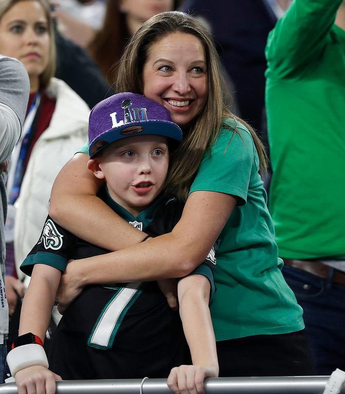 . Philadelphia Eagles fans celebrate after the NFL Super Bowl 52 football game between the Eagles and the New England Patriots Sunday, Feb. 4, 2018, in Minneapolis. The Eagles won 41-33. (AP Photo/Jeff Roberson)