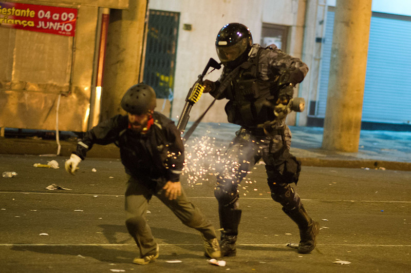 . A military police from the special unit Chope uses a tear gas gun late on June 19, 2013 to stop a protestor during clashes in the center of Niteroi, 10 kms from Rio de Janeiro. Protesters battled police late on June 19, even after Brazil\'s two biggest cities rolled back the transit fare hikes that triggered two weeks of nationwide protests.  The fare rollback in Sao Paulo and Rio de Janeiro marked a major victory for the protests, which are the biggest Brazil has seen in two decades. .  CHRISTOPHE SIMON/AFP/Getty Images