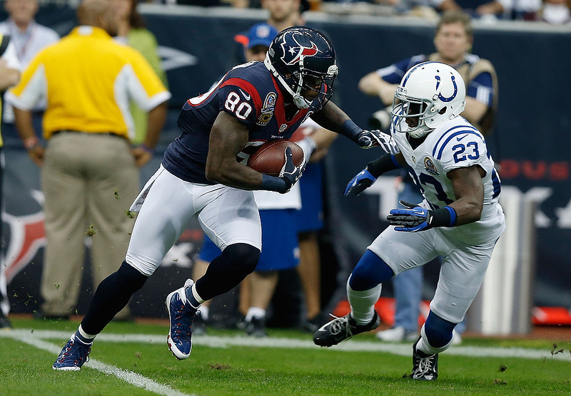 . Andre Johnson #80 of the Houston Texans runs the ball past Vontae Davis #23 of the Indianapolis Colts at Reliant Stadium on December 16, 2012 in Houston, Texas.  (Photo by Scott Halleran/Getty Images)