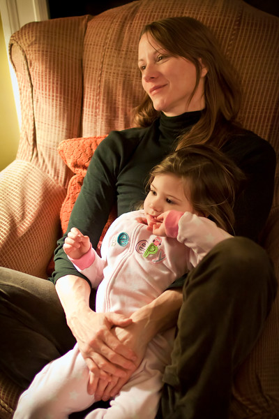 """After a day of playing outside in the snow Freja and Teri snuggle on the chair as they watch Kipper the Dog. It's the kid's favorite show and she's starting to use phrases from the show, such as saying, """"ready, steady, go!"""""""