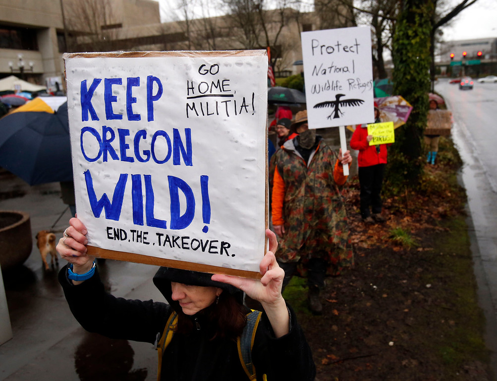 . Renee Irvin holds a sign during a rally against the occupation of the Malheur National Wildlife Refuge by Ammon Bundy and his armed followers, while joining the rally at the Federal Building in Eugene, Ore., Tuesday, Jan. 19, 2016. With the armed takeover of the national wildlife refuge in southeastern Oregon in its third week, Bundy and his armed group are still trying to muster up broad community support, so far without much luck. (Andy Nelson/The Register-Guard via AP) MANDATORY CREDIT