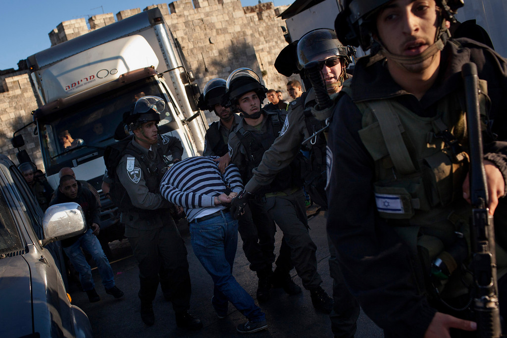 . Israeli Border Police arrest a Palestinian man during clashes in Jerusalem\'s Old City, Tuesday, April 2, 2013. Clashes erupted during a protest in support of Maysara Abu Hamdiyeh, 64, who was serving a life sentence for his role in a foiled attempt to bomb a busy cafe in Jerusalem in 2002, and died Tuesday of cancer in an Israeli jail. Tensions are high in Israeli lockups where thousands of Palestinian security prisoners are being held. (AP Photo/Bernat Armangue)
