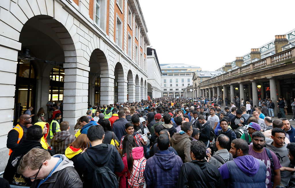 . People queue outside an Apple shop in London, Friday, Sept. 19, 2014. The new Apple iPhone 6 went on sale at the shop on Friday. (AP Photo/Kirsty Wigglesworth)