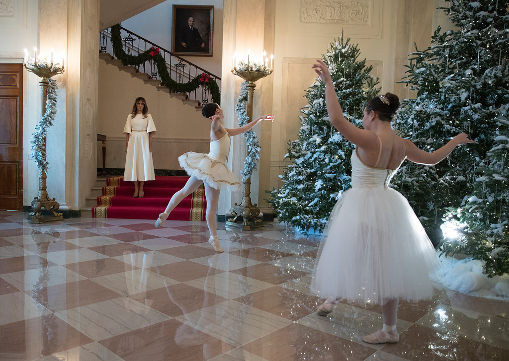 . First lady Melania Trump watches a ballerinas perform a piece from The Nutcracker among the 2017 holiday decorations in the Grand Foyer of the White House in Washington, Monday, Nov. 27, 2017. The First Lady honored 200 years of holiday traditions at the White House. (AP Photo/Carolyn Kaster)