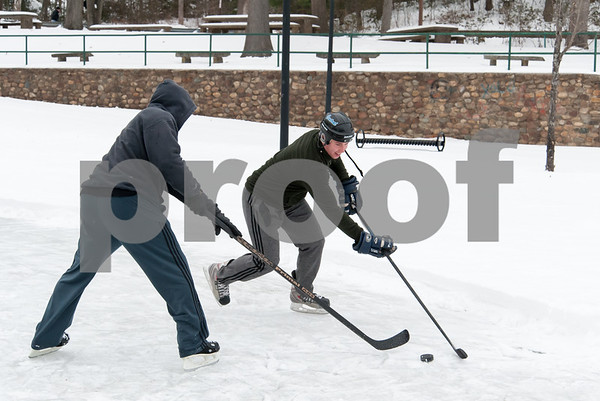 01/08/18 Wesley Bunnell | Staff Jack Edwards, L, defends against his son, Billy, in a friendly game of hockey on Monday afternoon at Rockwell Park in Bristol.