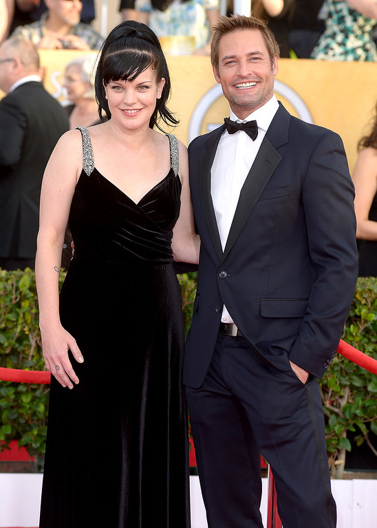 . Pauley Perrette and Josh Holloway arrives at the 20th Annual Screen Actors Guild Awards  at the Shrine Auditorium in Los Angeles, California on Saturday January 18, 2014 (Photo by Michael Owen Baker / Los Angeles Daily News)