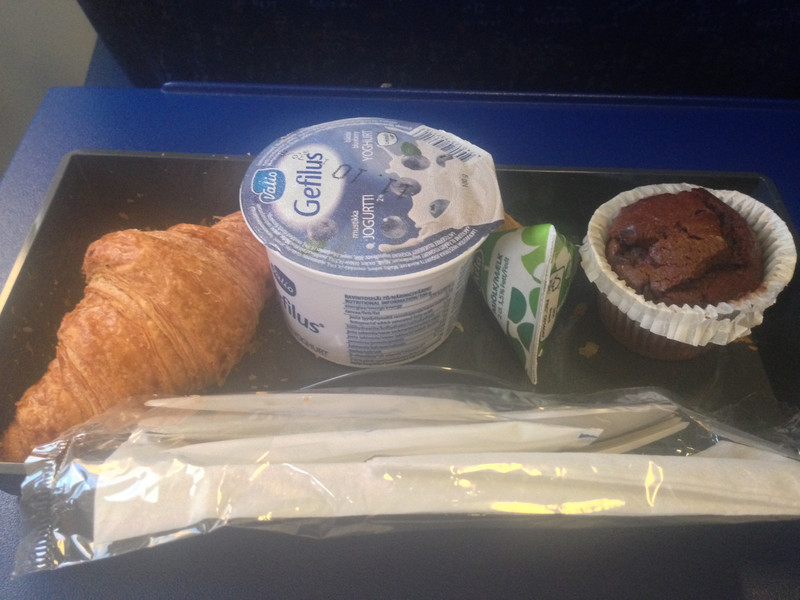 Breakfast on Air france - I did not know what to do with the tiny container of milk (in green triangle). I poured it in my coffee.