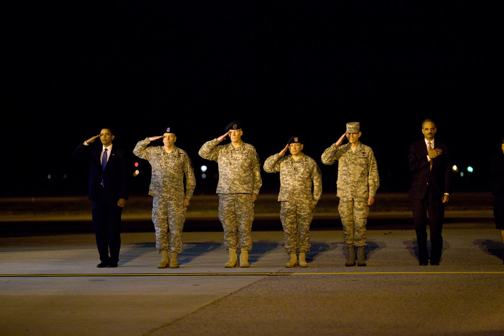 "Description of . Oct. 29, 2009 ""This photo was taken about 4AM after the President made an unannounced trip to Dover Air Force Base to pay respects to fallen troops coming back from Afghanistan. After meeting privately with the families, the President walked alone up the ramp of the cargo plane carrying the 18 caskets, all draped in American flags. I could see the emotion on his face as he walked from casket to casket, leaving a Presidential coin on each. When he was done, he paused for a few minutes, head bowed in prayer. I heard him tell others later how that was the most difficult moment of his Presidency thus far. Out of respect for the families, not all of who wanted their ceremony photographed, we can't show those pictures (but they will become part of Presidential archive.) (Official White House photo by Pete Souza)"