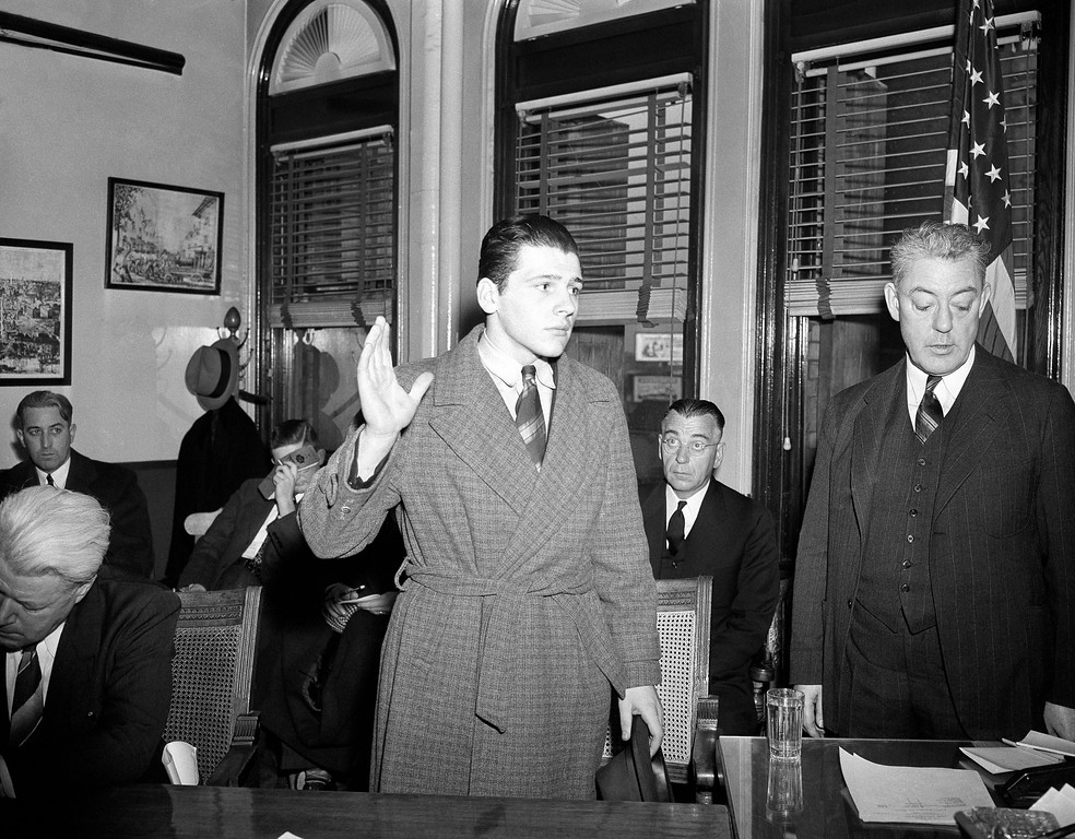 . Stanley F. Tomaszewski, 16, employee at Cocoanut Grove night club is sworn in as a witness at the state-city inquest in Boston into circumstances surrounding the tragedy which cost the lives of 479 persons, Nov. 30, 1942. (AP Photo/Peter J. Carroll)
