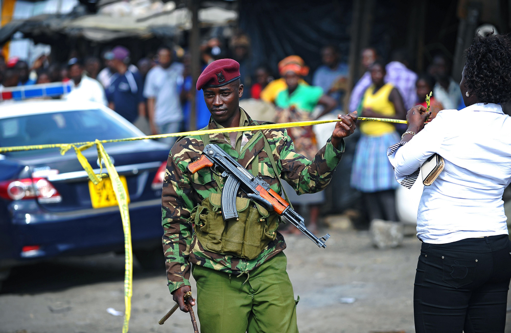 . A Kenyan policeman stands at the scene of an explosion in Gikomba on the outskirts of Nairobi\'s business district where twin blasts claimed at least ten lives on May 16, 2014. Ten people were killed and over 70 wounded when two bomb attacks in a busy market took place in the Kenyan capital Nairobi, the latest in a wave of unrest blamed on Islamist militants. (John Muchucha/AFP/Getty Images)