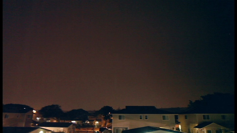 Power goes out in the neighborhood during a lightning storm.
