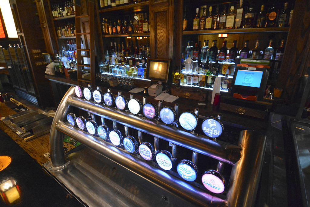 . The main downstairs bar at Three Blind Mice pub in Mount Clemens has a tower of beer taps. Ray J. Skowronek/Digital First Media