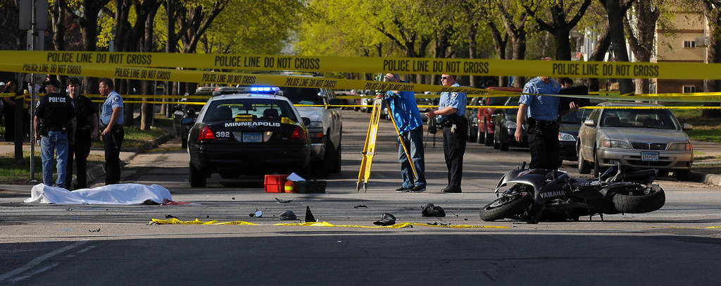 . Meanwhile, a police squad car responding to the shooting scene struck a motorcycle on West 26th St. near Blaisdell Ave. So. in Minneapolis, killing the driver and injuring a passenger.  (Pioneer Press: John Autey)