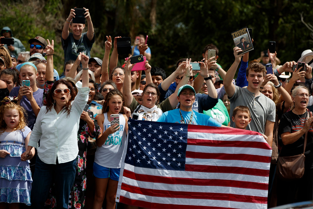 . Supporters of President Donald Trump cheer outside Firehouse 5 in Corpus Christi, Texas, Tuesday, Aug. 29, 2017, as the president received a briefing on Harvey relief efforts. (AP Photo/Evan Vucci)