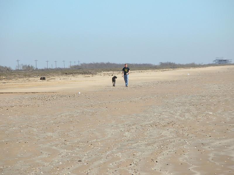 someone walking his dog on McFaddin beach