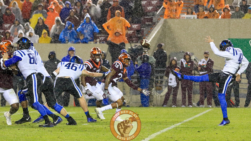 Duke punts the football away after another defensive stop as the rain begins to increase in volume in the second half. (Mark Umansky/TheKeyPlay.com)