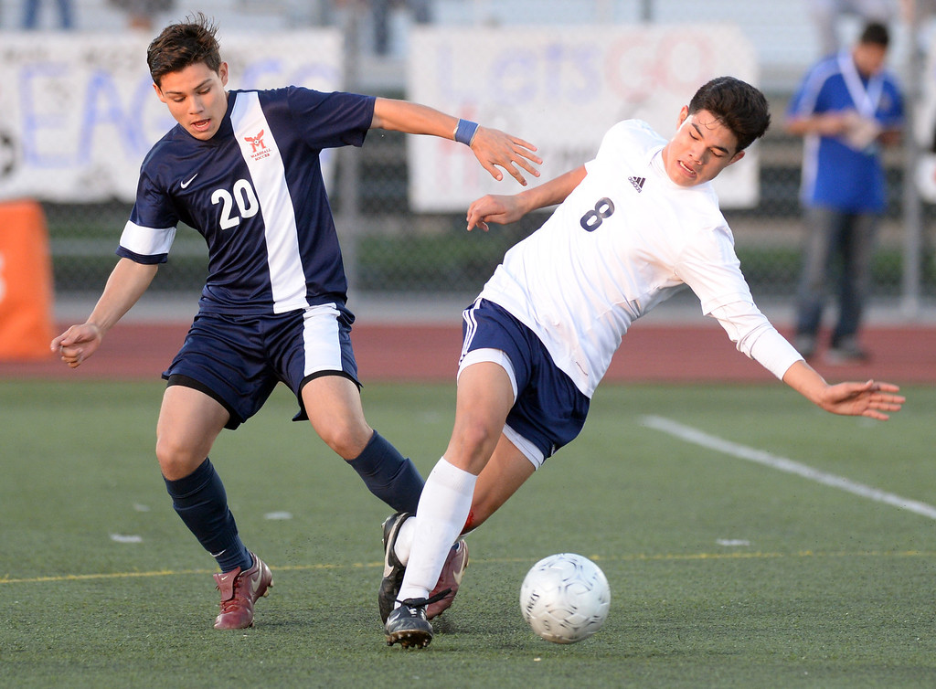 . Marshall\'s Edgar Figueroa (#20) tangles with Baldwin Park\'s Andy Castillo (#8) in their CIF-SS Division 5 boys soccer game at Warren High School in Downey on Friday March 7, 2014. Baldwin Park beat Marshall 5-4 in penalty kicks after scoring 0-0 in overtime. (Staff Photo by Keith Durflinger/San Gabriel Valley Tribune)