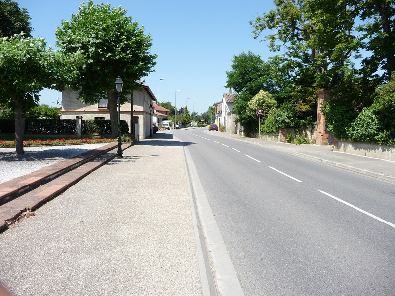 This is Saint-Lys, mid-day. I think we saw 3 cars and 4 people in the hour we sat in the park.