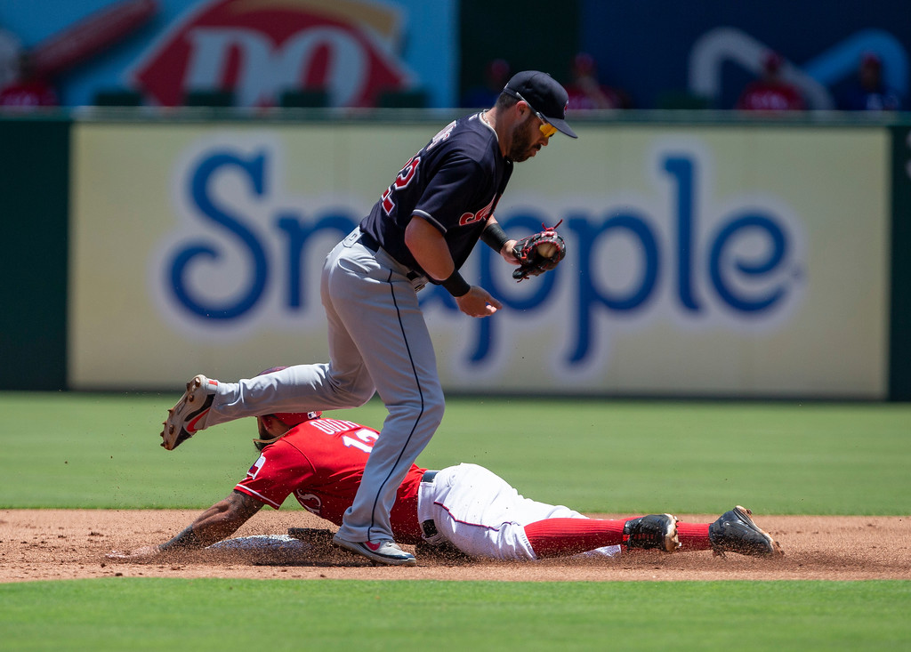 . Texas Rangers\' Rougned Odor (12) steals second base during the first inning of a baseball game against the Cleveland Indians, Sunday, July 22, 2018, in Arlington, Texas. (AP Photo/Sam Hodde)