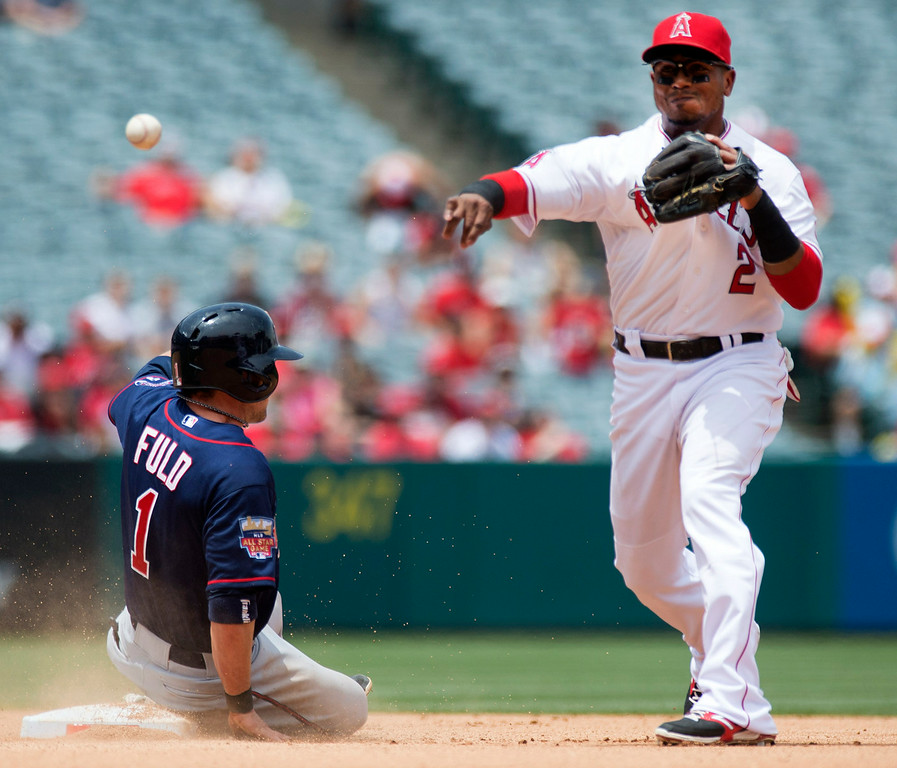 . Angels shortstop Erick Aybar (#2) forces out Twins\' Sam Fuld (#1) at second base and attempts the double play at Angel Stadium in Anaheim on Thursday June 26, 2014. (Photo by Keith Durflinger/Whittier Daily News)