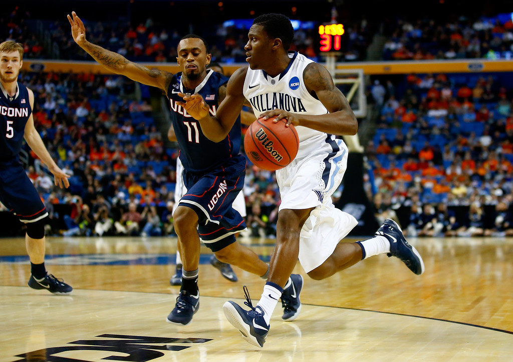 . BUFFALO, NY - MARCH 22: Dylan Ennis #31 of the Villanova Wildcats drives to the basket as Ryan Boatright #11 of the Connecticut Huskies defends during the third round of the 2014 NCAA Men\'s Basketball Tournament at the First Niagara Center on March 22, 2014 in Buffalo, New York.  (Photo by Jared Wickerham/Getty Images)