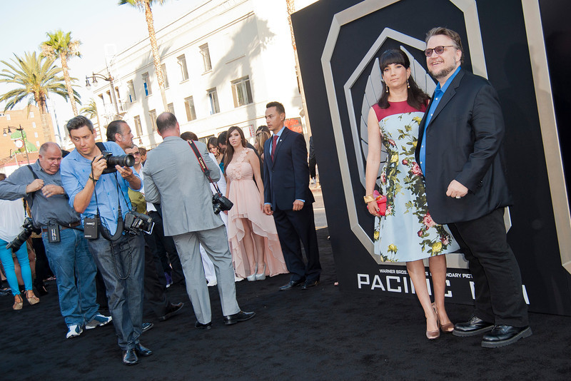 HOLLYWOOD, CA - JULY 09: Filmmaker Guillermo del Toro (R) and Lorenza Newton arrive at the premiere of Warner Bros. Pictures' and Legendary Pictures' 'Pacific Rim' at Dolby Theatre on Tuesday, July 9, 2013 in Hollywood, California. (Photo by Tom Sorensen/Moovieboy Pictures)