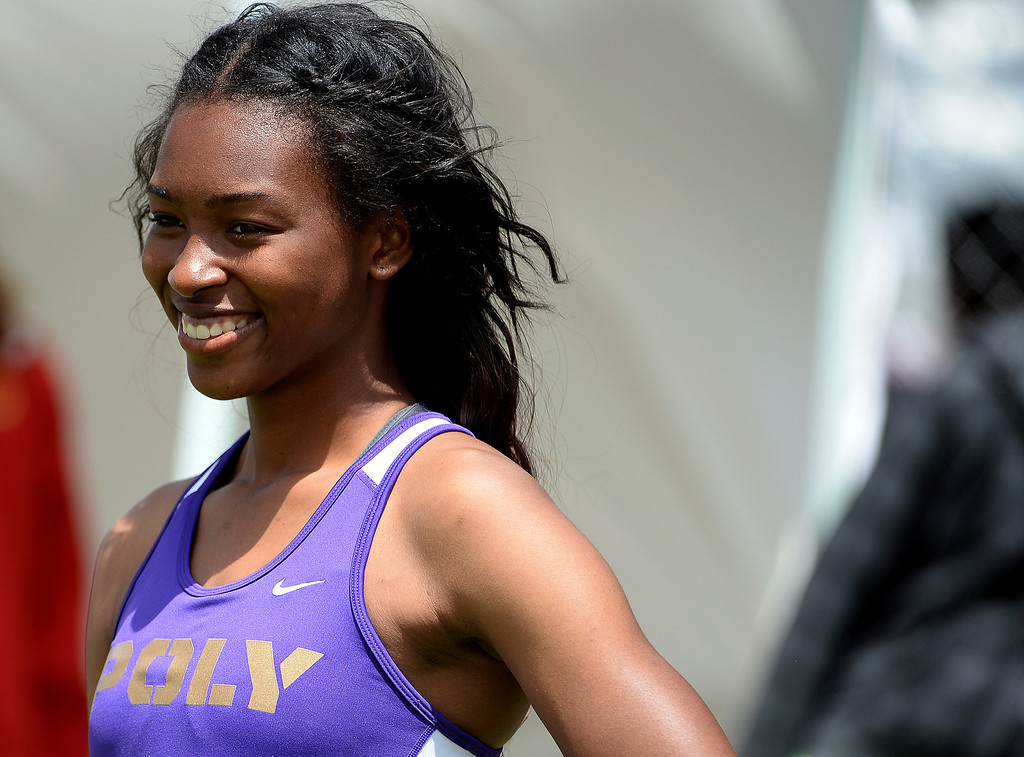 . Long Beach Poly\'s Ariana Washington after running the final leg of the 4x100 meter relay Invitational during the Mt. SAC Relays in Hilmer Lodge Stadium on the campus of Mt. San Antonio College in Walnut, Calif., on Saturday, April 19, 2014.  (Keith Birmingham Pasadena Star-News)
