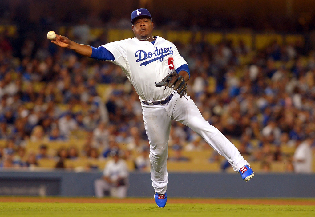 . <b>Juan Uribe #5 | 3B | Bats: R, Throws: R <br />GP: 132     AB: 388     R: 47    H: 108     2B: 22  </b> <b>3B: 2     HR: 12     RBI: 50    BB: 30     SO: 81  </b> <b>SB: 5     BA: .278     OBP: .331    SLG: .438     OPS: .769</b> <br />(Andy Holzman/Los Angeles Daily News)