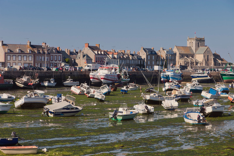 BARFLEUR, FRANCE - JULY 3: Fishing and recreational boats at low tide in the harbor of Barfleur, France on July 3, 2011. Barfleur is a picturesque fishing village in Basse Normandy.