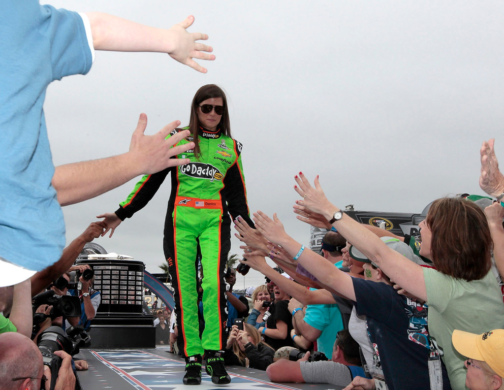 Description of . NASCAR driver Danica Patrick greets fans before the start of the NASCAR Sprint Cup Series Daytona 500 race at the Daytona International Speedway in Daytona Beach, Florida February 24, 2013. REUTERS/Joe Skipper