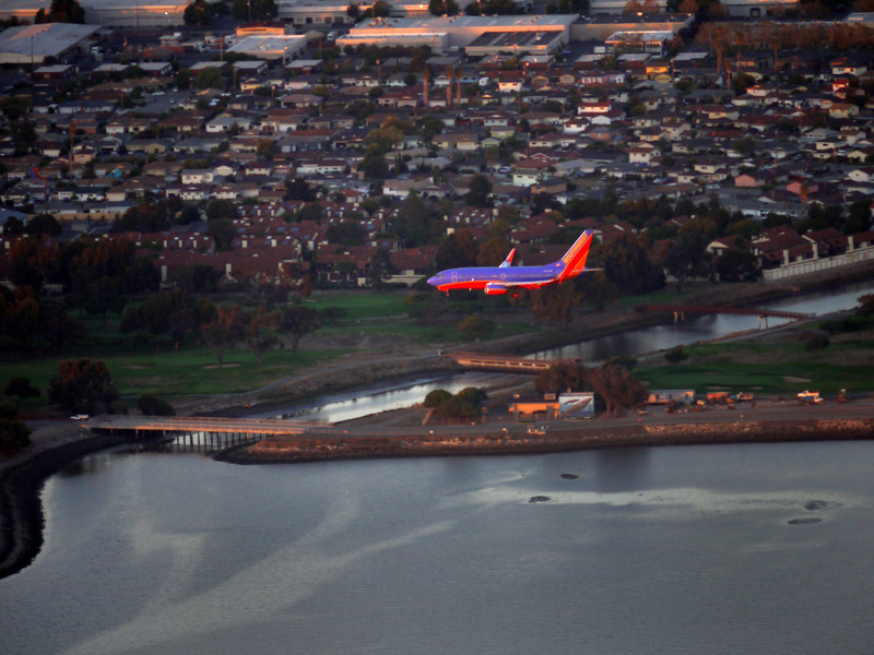 A Southwest plane heading for a landing at Oakland airport.
