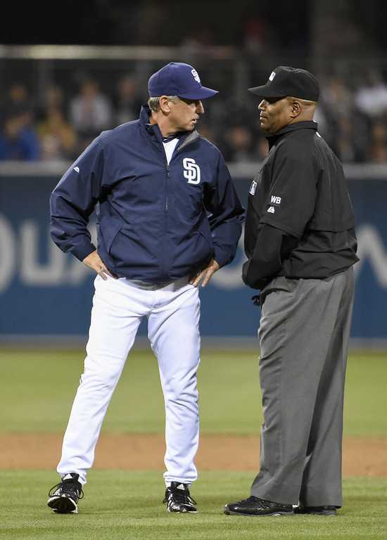 . SAN DIEGO, CA - APRIL 15:  Bud Black manager of the San Diego Padres argues a call with umpire Laz Diaz during the fifth inning of a  baseball game against the Colorado Rockies at Petco Park April 15, 2014 in San Diego, California. All uniformed team members are wearing jersey number 42 in honor of Jackie Robinson Day.  (Photo by Denis Poroy/Getty Images)