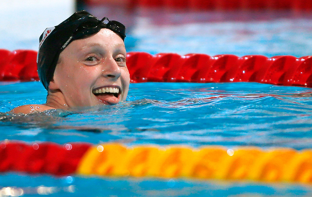 . Katie Ledecky of the U.S. smiles after winning the women\'s 800m freestyle final during the World Swimming Championships at the Sant Jordi arena in Barcelona August 3, 2013. The 16-year-old clocked a time of eight minutes 13.86 seconds to set a world record to win the event on Saturday and complete a rare treble of distance titles.  REUTERS/Albert Gea