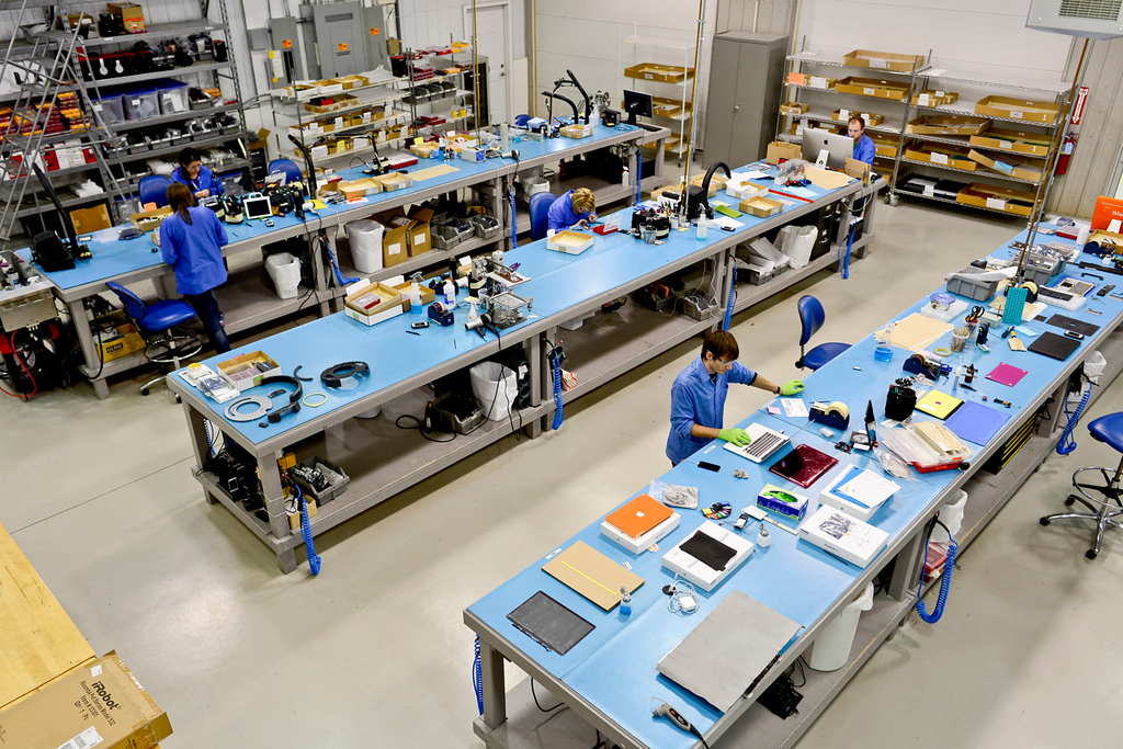 . Employees work at the disassembly room at the ColorWare facilities. (Pioneer Press: Simon Guerra)