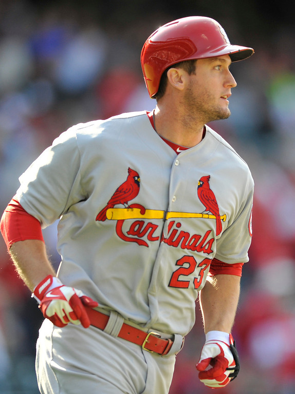 . St. Louis Cardinals\' David Freese runs out an RBI-double against Colorado Rockies relief pitcher Chad Bettis during the eighth inning of a baseball game on Thursday, Sept. 19, 2013, in Denver. (AP Photo/Jack Dempsey)