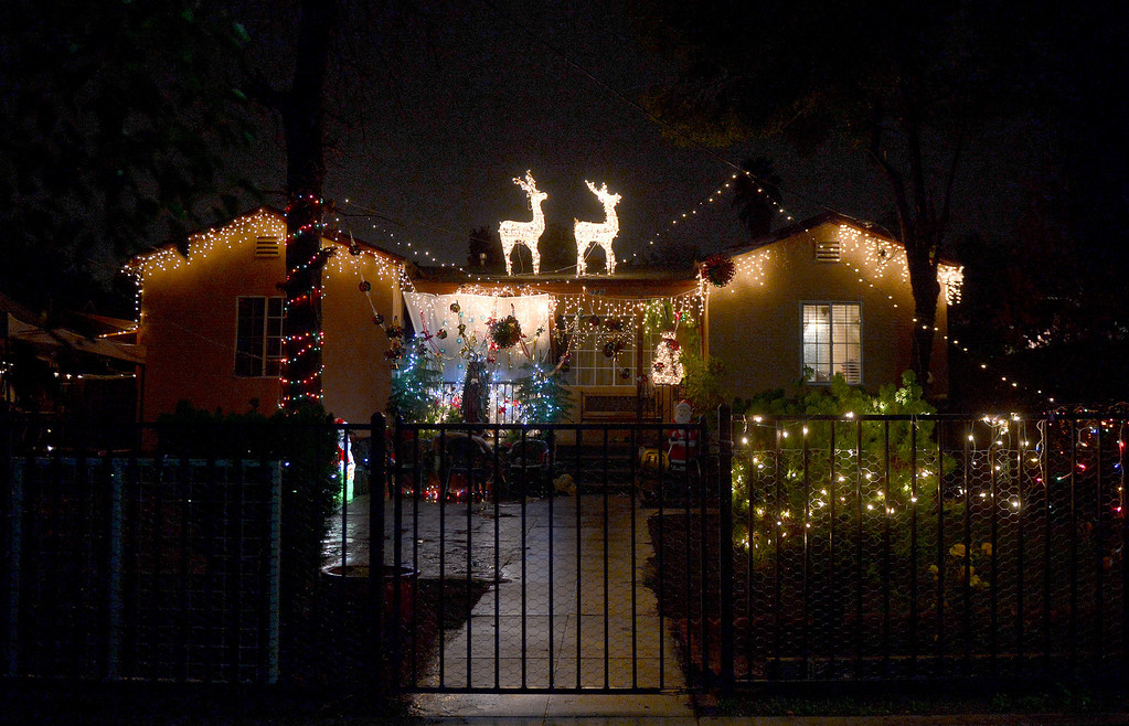. A house is lit up for the holidays on the 900 block of North Summit Avenue in Pasadena Thursday night, December 19, 2013. (Photo by Sarah Reingewirtz/Pasadena Star-News)