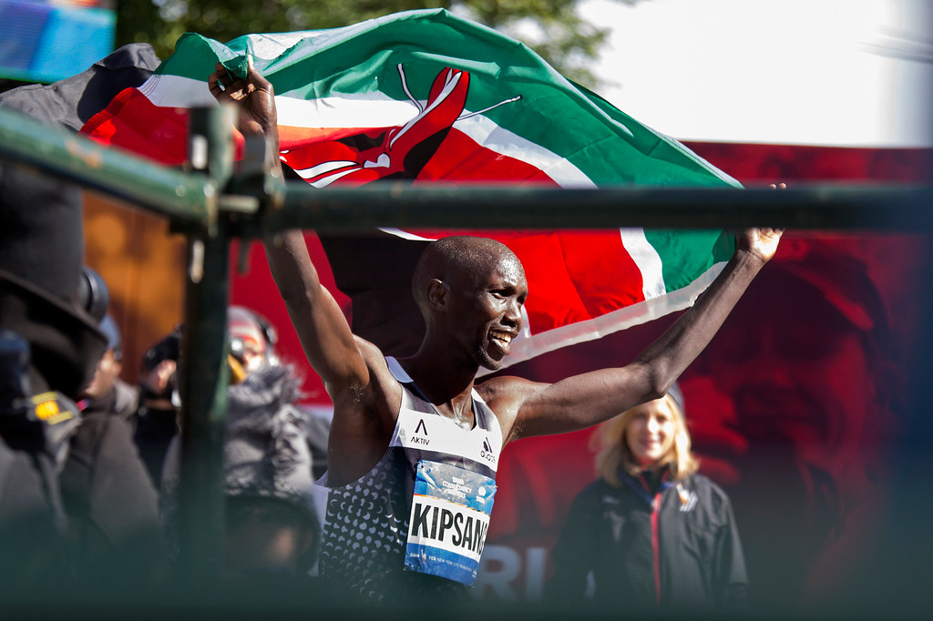 . Wilson Kipsang of Kenya hoists his country\'s flag after winning the New York City Marathon in New York Sunday, Nov. 2, 2014. Kipsang won in an unofficial time of 2 hours, 10 minutes, 59 seconds. (AP Photo/Craig Ruttle)