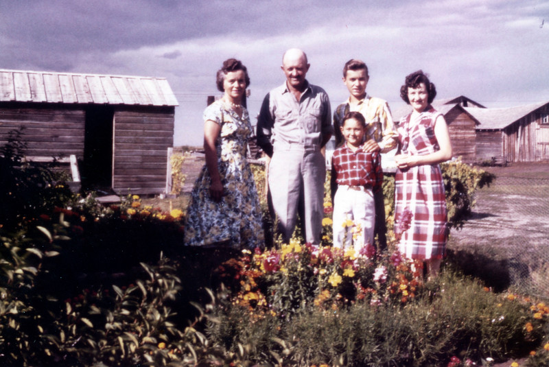 Lottie, Wilhelm, Willie, Alice, Gary taken right in front of the porch on Lottie & Bill's yard - in front of Lottie's flower beds. c 1958.  Could have been taken on Alice and Herb's camera - perhaps they had colour film.