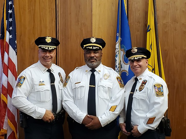 Justin Muszynski | Staff From left, Bristol police Chief Brian Gould, Capt. Stephen Tavares, who was promoted Thursday, and Capt. Richard Guerrera.