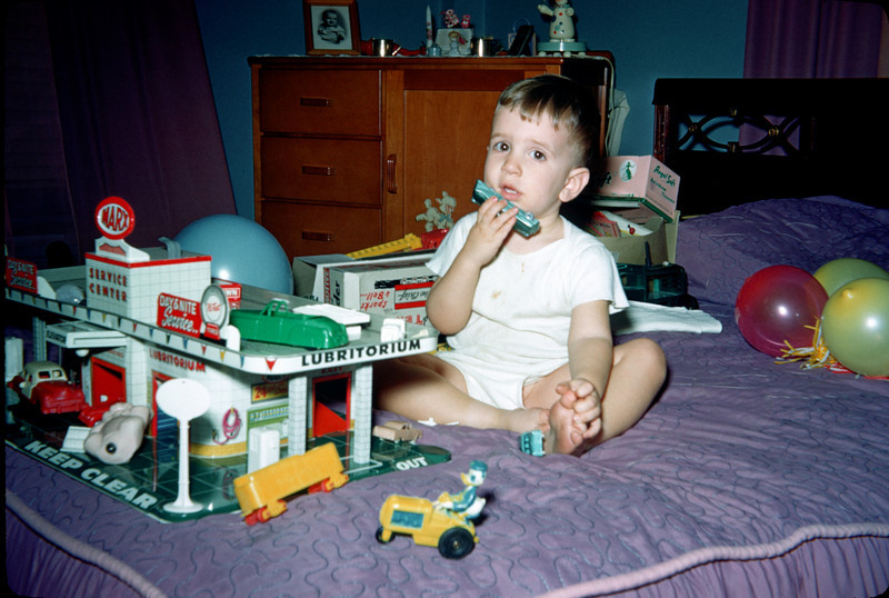 richard on bed with toys 2.jpg