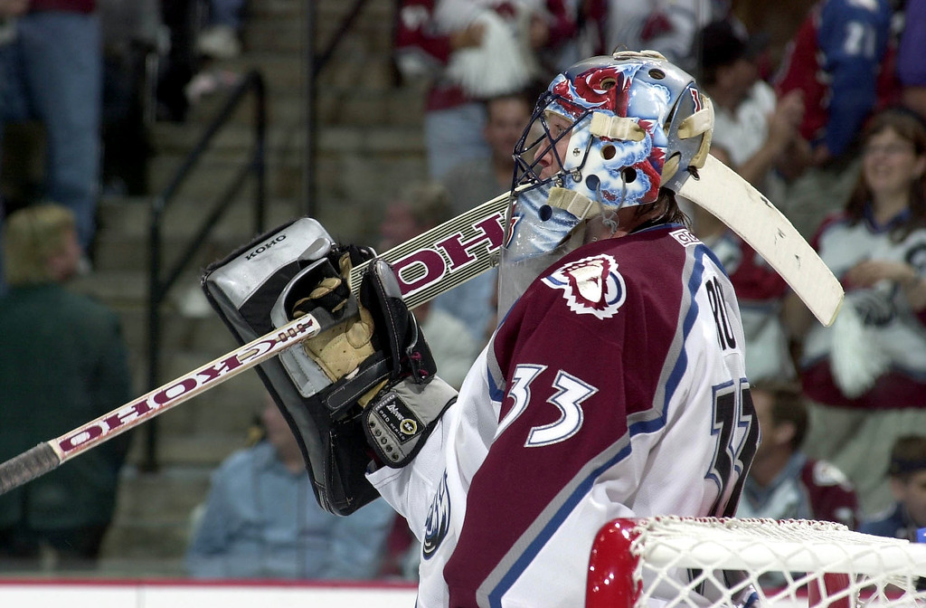 . Avalanche goalie Patrick Roy pauses during a lull in the action during the second period of game 7 of the Stanley Cup finals in Denver in 2001.  (John Leyba/The Denver Post)