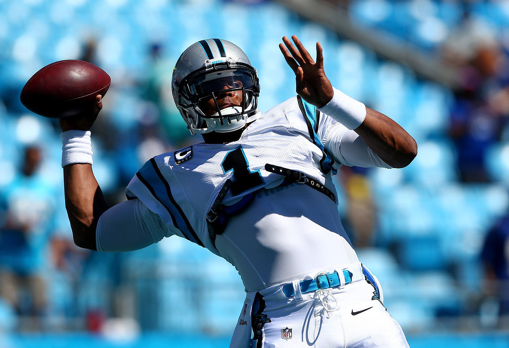 . Cam Newton #1 of the Carolina Panthers warms up before their game against the New York Giants at Bank of America Stadium on September 22, 2013 in Charlotte, North Carolina.  (Photo by Streeter Lecka/Getty Images)