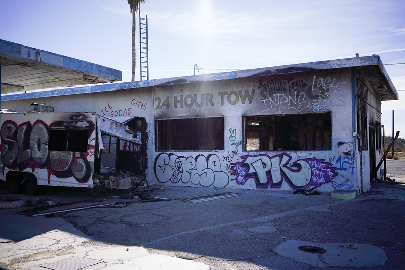 This was a gas station once. Now, it's full of grafitti, empty and an RV is on its side