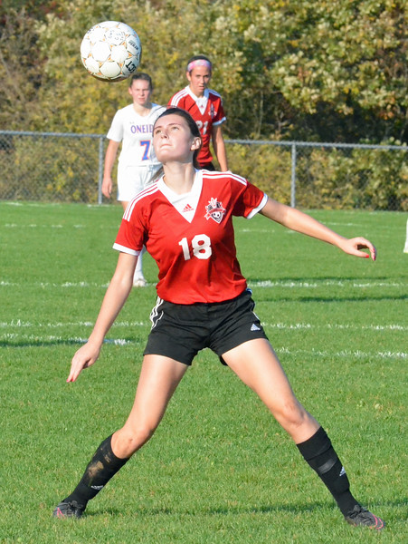 KYLE MENNIG - ONEIDA DAILY DISPATCH Vernon-Verona-Sherrill's Sarah Wayland-Smith plays the ball out of the air against Oneida during their Section III Class B playoff match in Oneida on Tuesday, Oct. 18, 2016.