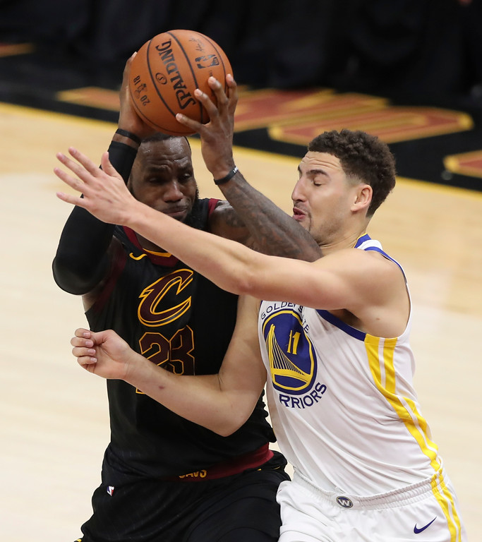 . Cleveland Cavaliers\' LeBron James goes to the basket against Golden State Warriors\' Klay Thompson in the first half of Game 4 of basketball\'s NBA Finals, Friday, June 8, 2018, in Cleveland. (AP Photo/Carlos Osorio)