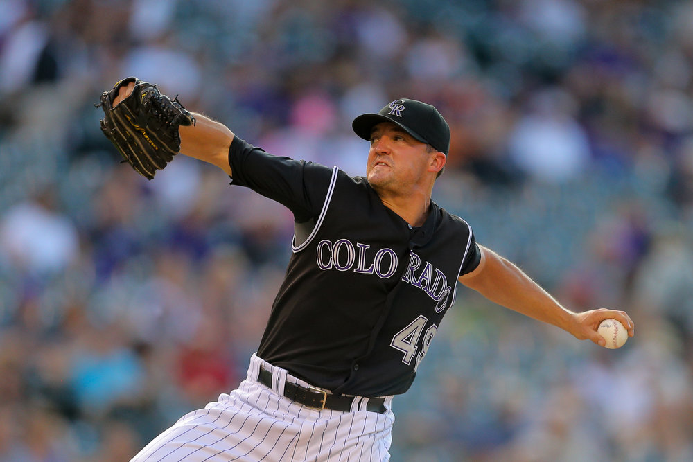. Relief pitcher Rex Brothers #49 of the Colorado Rockies delivers to home plate during the ninth inning against the Cincinnati Reds at Coors Field on August 17, 2014 in Denver, Colorado. The Rockies defeated the Reds 10-9. (Photo by Justin Edmonds/Getty Images)
