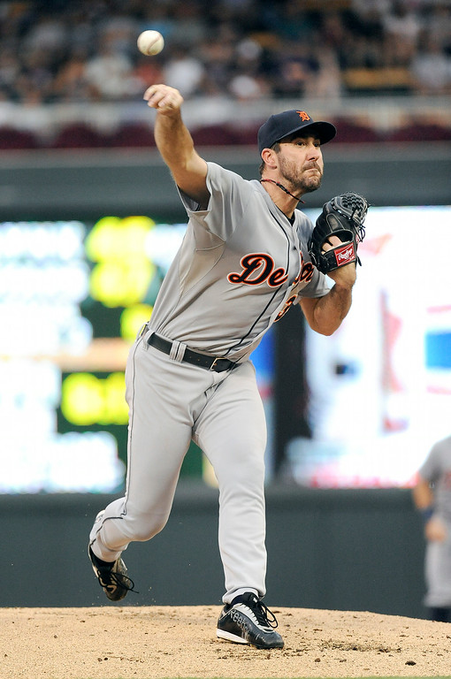 . Detroit Tigers pitcher Justin Verlander throws against the Minnesota Twins during the first inning of a baseball game Saturday, Aug. 23, 2014 in Minneapolis.  (AP Photo/Craig Lassig)