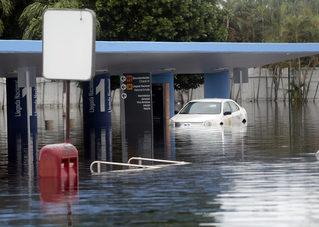 . Partial view at the airport of Acapulco, Guerrero state, Mexico, on September 17, 2013 flooded by heavy rains that have been hitting the country. Mexican authorities scrambled Tuesday to launch an air lift to evacuate tens of thousands of tourists stranded amid floods in the resort of Acapulco following a pair of deadly storms. At least 48 people were killed and thousands evacuated from towns on the Pacific and Gulf of Mexico coasts over the weekend as Tropical Storm Manuel and downgraded Hurricane Ingrid set off landslides and floods that damaged bridges, roads and homes. Pedro PARDO/AFP/Getty Images