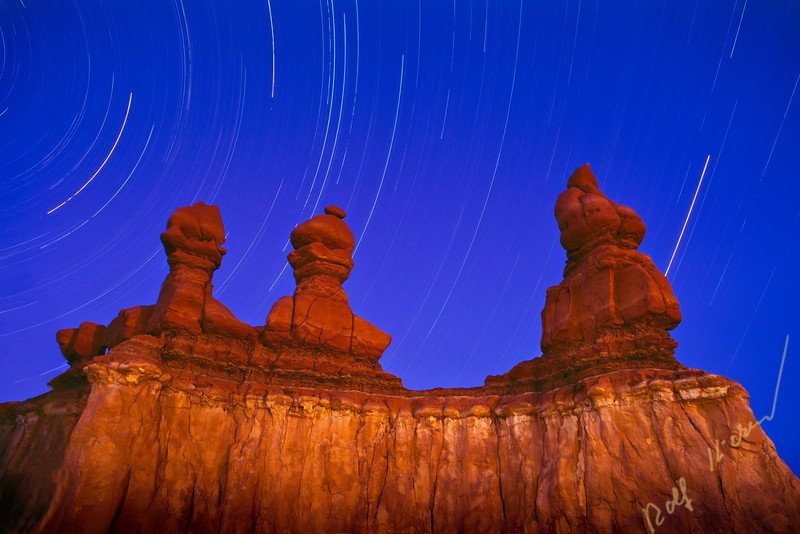 Goblin Valley State Park, sandstone formation during night, lit up with flash, long exposure, star trail, hoodoos or so called goblins, Utah, USA.